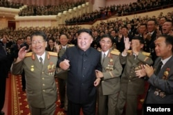 FILE - North Korean leader Kim Jong Un reacts during a celebration for nuclear scientists and engineers who contributed to a hydrogen bomb test, in this undated photo released by North Korea's Korean Central News Agency in Pyongyang, Sept. 10, 2017.
