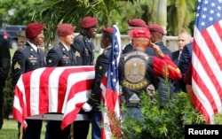 FILE - An honor guard carries the coffin of U.S. Army Sergeant La David Johnson, who was among four Special Forces soldiers killed in Niger, at a graveside service in Hollywood, Fla., Oct. 21, 2017.