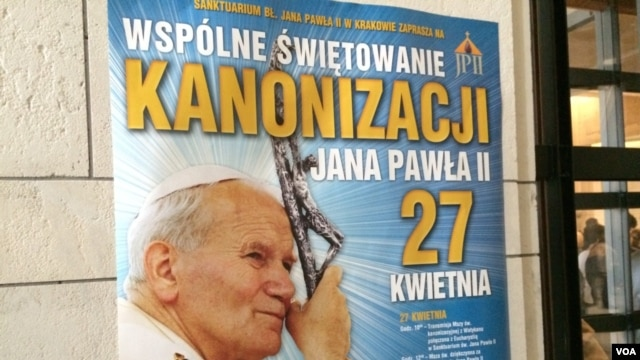 "Posters all around town say ""Communal Celebration of the canonization of John Paul II, April 27,"" Cracow, Poland, April 22, 2014. (Jerome Socolovsky/VOA)"