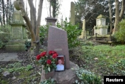 FILE - The grave of murdered ex-KGB agent Alexander Litvinenko is seen at Highgate Cemetery in London, Britain, Jan. 21, 2016.