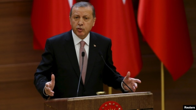 Turkish President Recep Tayyip Erdogan makes a speech during his meeting with mukhtars at the Presidential Palace in Ankara, Turkey, Nov. 26, 2015.