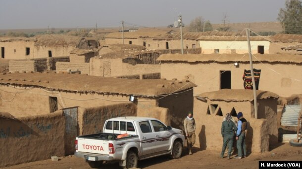 This village, abandoned after IS militants took over the area, is a temporary headquarters for Hashd Shaabi forces fighting their way to the strategic city of Tal Afar, in Delawaya, Iraq, Dec. 17, 2016.