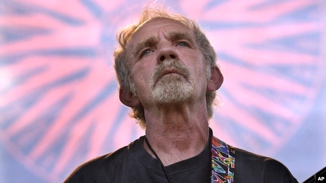 FILE - Singer-songwriter J.J. Cale plays during the Eric Clapton Crossroads Guitar Festival in Dallas, Texas, June 5, 2004.