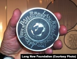 The Rosetta Disk fits in the palm of your hand, yet it contains over 13,000 pages of information on over 1,500 human languages. The design shows headlines in the eight major languages of the world today.