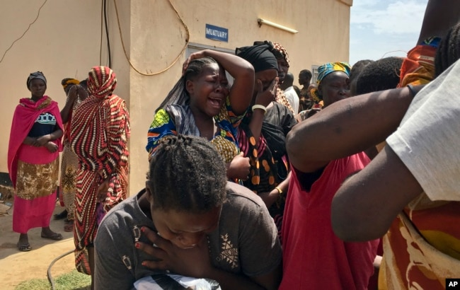 Relatives of the six slain aid workers grieve in Juba, South Sudan, March 27, 2017. Twelve aid workers have been killed so far this year in South Sudan.