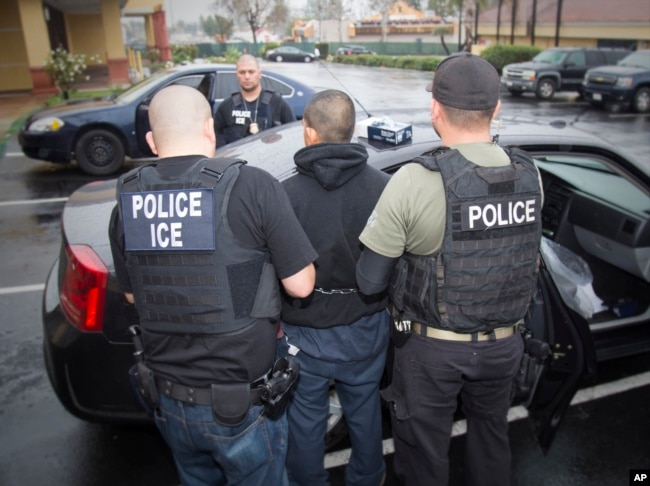 "FILE - A photo released by U.S. Immigration and Customs Enforcement (ICE) shows a foreign national being arrested during a targeted enforcement operation conducted by ICE agents, Feb. 7, 2017. According to ICE guidelines, its agents avoid ""sensitive locations"" which include schools, hospitals and houses of worship."