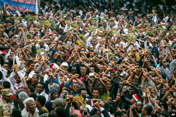FILE - In this Sunday, Oct. 2, 2016 file photo, protesters chant slogans against the government during a march in Bishoftu, in the Oromia region of Ethiopia.