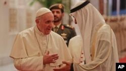 Pope Francis is welcomed by Abu Dhabi's Crown Prince Sheikh Mohammed bin Zayed Al Nahyan, upon his arrival at the Abu Dhabi airport, United Arab Emirates, Sunday, Feb. 3, 2019.