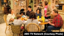"""In this image released by ABC, Roseanne Barr, left, and John Goodman appear in a scene from the reboot of """"Roseanne."""""""