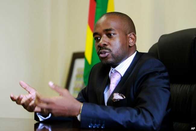 FILE - In this March 8, 2018 photo, the leader of MDC-T, Zimbabwe's biggest opposition party, Nelson Chamisa gestures during an interview with the Associated Press in Harare.