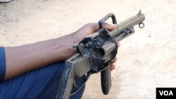 Community patrols often carry critically manufactured weapons in their efforts to ward off attackers.  (H. Shehu/VOA Hausa)