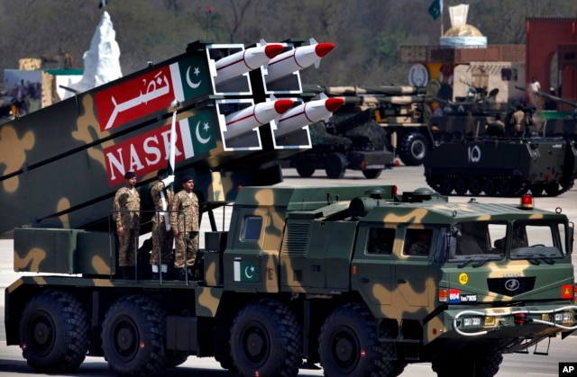 FILE - A Nasr missile is loaded on vehicle during the Pakistan National Day parade in Islamabad, Pakistan, March 23, 2015.