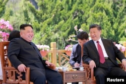 FILE - North Korean leader Kim Jong Un meets with China's President Xi Jinping, in Dalian, China in this undated photo released on May 9, 2018 by North Korea's Korean Central News Agency (KCNA).