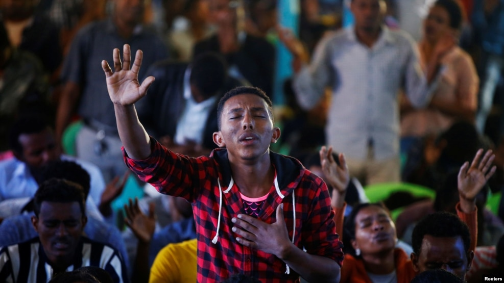 A man attends a prayer session at Biftu Bole Lutheran Church during a prayer and candle ceremony for protesters who died in the town of Bishoftu two weeks ago during Irreecha, the thanksgiving festival of the Oromo people, in Addis Ababa, Ethiopia, October 16, 2016.