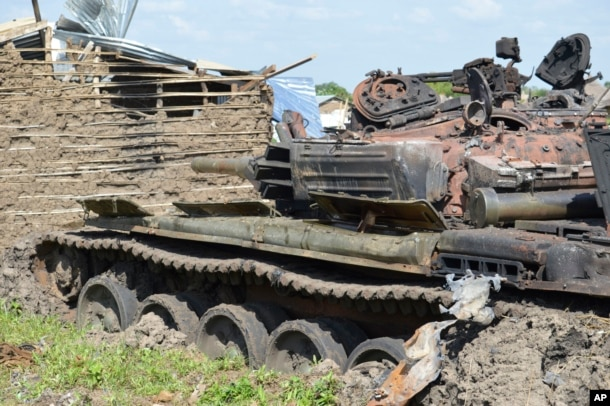 FILE - Tanks that have been destroyed during fighting between forces of Salva Kiir and Riek Machar, July 10, 2016 in Jabel area of Juba, South Sudan, July 16, 2016.