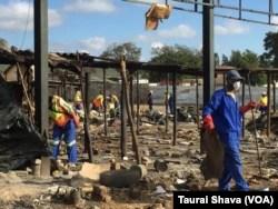 Workers demolishing some of the vendors' stalls. (Photo: Taurai Shava)