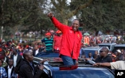 Kenya's President Uhuru Kenyatta gestures to supporters as he leaves an election rally at Uhuru Park in downtown Nairobi, Kenya, Sept. 9, 2017.