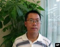 中国维权律师滕彪在北京一家餐厅里(2013年8月14日)