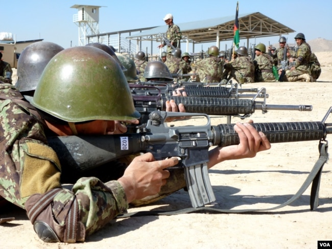 Afghan National Army soldiers learn how to shoot at the Kabul Military Training Center