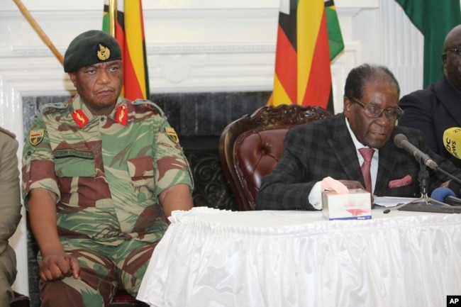FILE - Zimbabwean President Robert Mugabe delivers his speech during a live broadcast at State House in Harare, Nov, 19, 2017.
