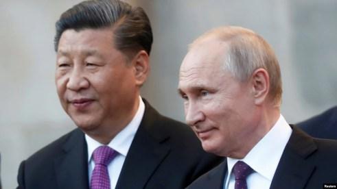 Chủ tịch Tập Cận Bình và Tổng thống Putin trong cuộc gặp hôm 5/6.
