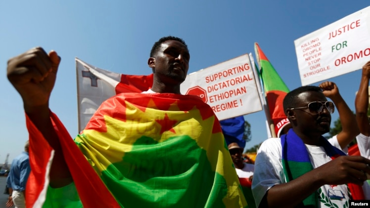 FILE - Ethiopian migrants, all members of the Oromo community of Ethiopia living in Malta, protest against the Ethiopian regime.