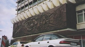 """Walter Womacka's bronze relief """"Man Overcomes Time and Space"""" (1969) on the House of Travel at Berlin Alexanderplatz (author's photo)"""
