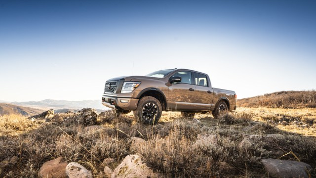 Nissan Titan truck driving on rocky desert