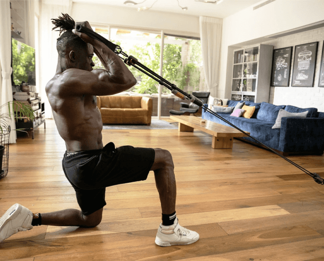A man exercising using the Hyfit Gear 1 in his home.