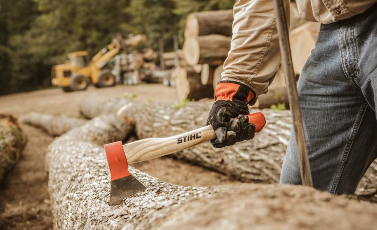 Lop off tree limbs for kindling with the Stihl woodcutter/forestry hatchet