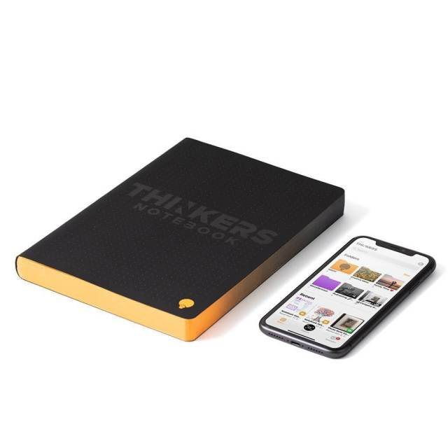 The Thinker's Notebook next to a smartphone.