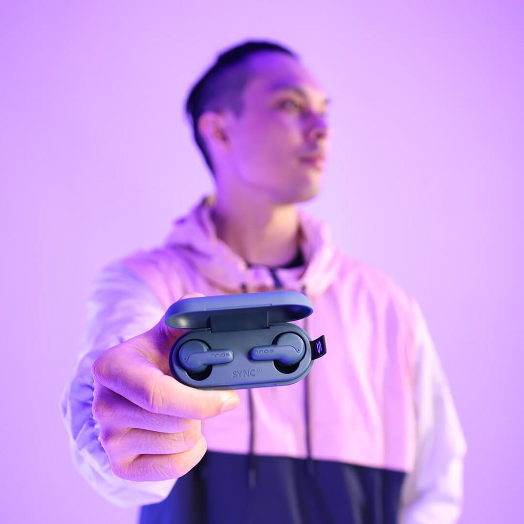 Soul's Sync-ANC on display held by a guy in a purple room.