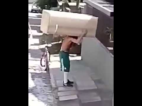 Guy Carries Refrigerator By Bicycle In Amazing Feat Of Strength