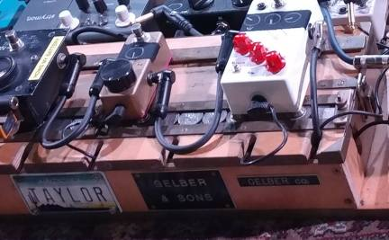 Closeup on Goldsmith's pedalboard (photo by Eric James)