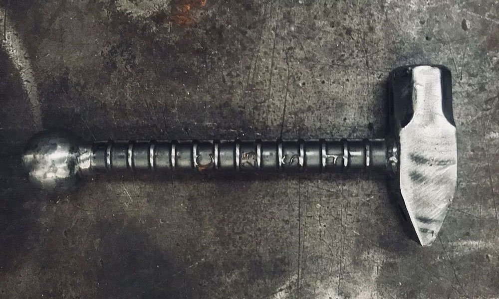 This Acme Sledgeworks Sledgehammer Is The Piece of Workout Gear You're Missing