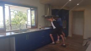 Kurt the splashback maker and Fred adjusting the rangehood, which wasn't quite level