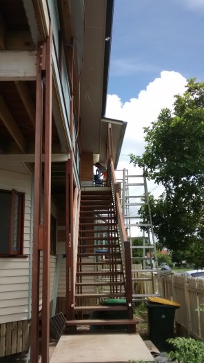 Peta working on the scaffolding past the front deck