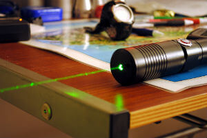 green-laser-on-table