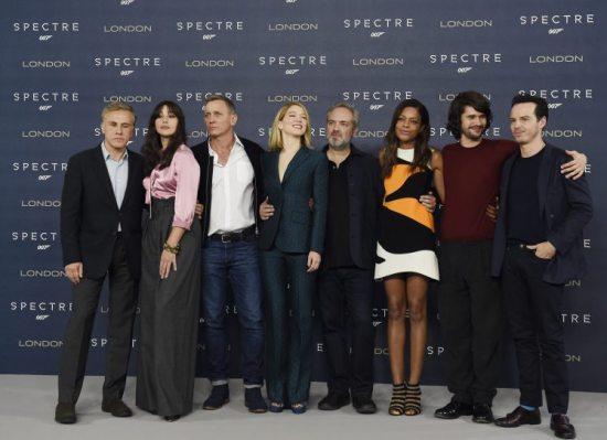 007 Spectre (L-R) Austrian actor Christoph Waltz, Italian actress Monica Belluci, British actor Daniel Craig, French actress Lea Seydoux, British director Sam Mendes, British actress Naomi Harris, British actor Ben Whishaw and Irish actor Andrew Scott pose for photographers during a photocall to unveil the new James Bond film 'Spectre' at a hotel in Central London, Britain, 22 October 2015. The 24th Bond movie will be released in British theaters on 26 October, the same day as its world premiere in London. EPA/FACUNDO ARRIZABALAGA