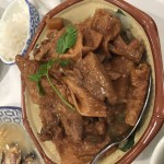 Braised duck with tofu skins, served in an octogonal bowl.