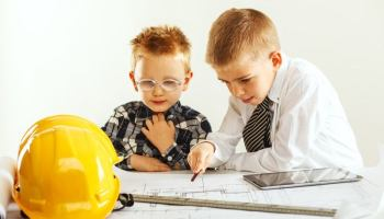 Two small boys dressed as a manager and an engineer representing the idea of immature management