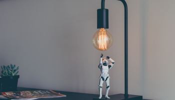 Toy Star Wars stormtrooper reaching for a lightbulb