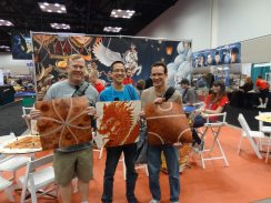 GeekDads Dave, Jonathan, and John show off tiles from Giant Tsuro at the Calliope Games booth.