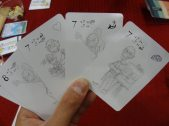Re: Your Brains is a zombie-vs-human card game. As the zombie, try to get the human's brains through force, intellectual arguments, or emotional pleas. (Unfinished prototype pictured)
