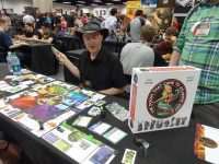 Keith Baker got to demo a nice shiny copy of The Doom That Came to Atlantic City at the Cryptozoic booth. (They didn't have the plastic miniatures available yet.)