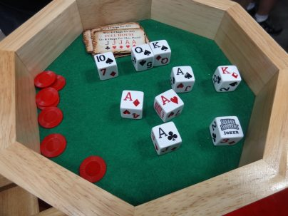 The dice are designed so that any hand of poker or rummy can be made using these nine dice.