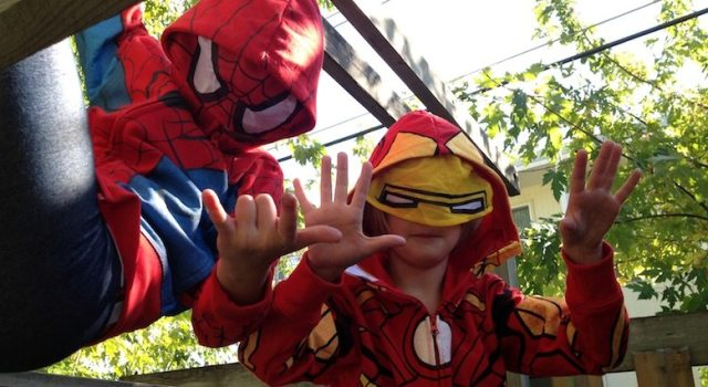 Wearing their costume hoodies Spiderman and Ironman team up to fight evil on a chilly fall afternoon. Photo by Ryan Carlson 2013