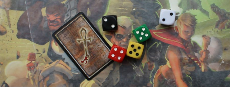 The Ankh Card and colored dice.