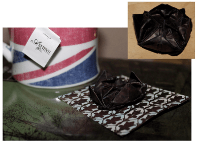 "Make a Sherlock Black Lotus pin by using dark paper with and origami ""lotus blossom"" pattern."