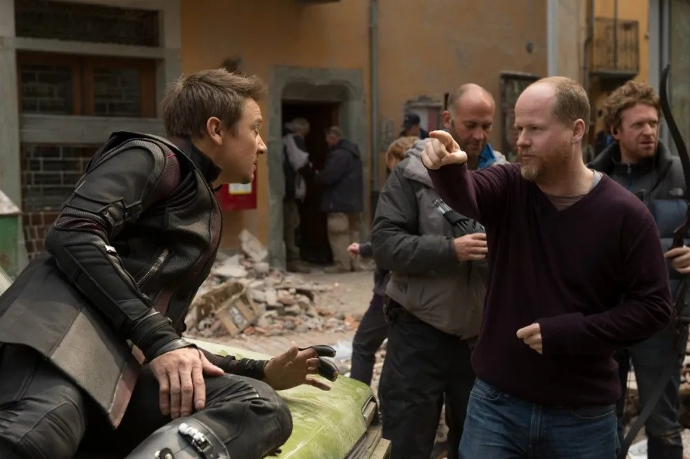 "Whedon giving direction to Jeremy Brenner (""Hawkeye"") on set - Photo: Disney/Marvel"
